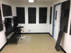 Newly spruced up room with sound-proof panels, custom door, new carpet and desk.